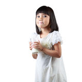 Happy little Asian girl holding a cup of milk Stock Photography