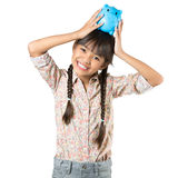 Happy little asian girl with piggy bank Royalty Free Stock Photos