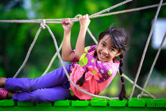 Happy little asian girl on the playground Stock Photography