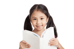 Happy little asian girl  read a book Stock Photo
