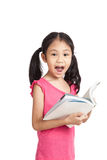 Happy little asian girl  read a book Royalty Free Stock Photos