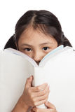 Happy little asian girl  read a book Royalty Free Stock Image
