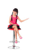 Happy little asian girl sitting on high chair Royalty Free Stock Photography