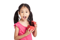 Happy little asian girl  surprise with red gift box Royalty Free Stock Image