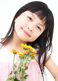 Happy little girl with yellow daisy Stock Photo