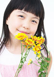 Happy little girl with yellow daisy Stock Photography