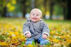 Happy little baby in the autumn park Royalty Free Stock Photos
