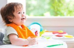 Happy little baby boy with a big smile. Eating food Royalty Free Stock Images