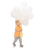 Happy little baby boy with bunch of balloons Stock Photography