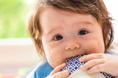 Happy little baby boy eating food Stock Images