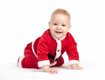 Happy little baby boy in Santa costume Royalty Free Stock Photos