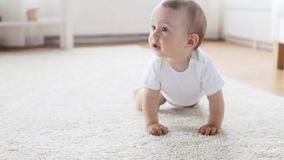 Happy little baby crawling in living room at home 8