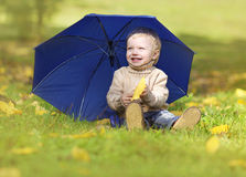 Happy little baby enjoying warm sunny autumn day in the park Royalty Free Stock Photos