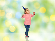 Happy little baby girl with birthday party hat Royalty Free Stock Photo