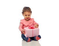Happy little baby girl with birthday present Royalty Free Stock Images
