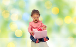 Happy little baby girl with birthday present Stock Photos