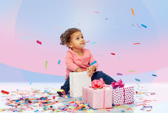 Happy little baby girl with birthday presents Royalty Free Stock Image