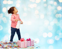 Happy little baby girl with birthday presents Stock Image