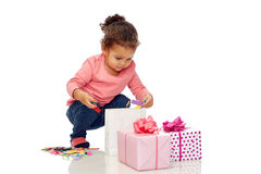 Happy little baby girl with birthday presents Royalty Free Stock Photography