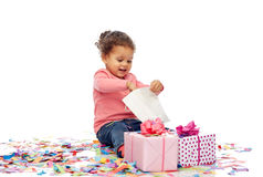 Happy little baby girl with birthday presents Royalty Free Stock Photos