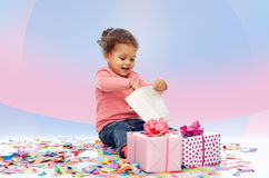 Happy little baby girl with birthday presents Royalty Free Stock Photo