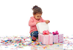 Happy little baby girl with birthday presents Stock Photos