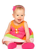 Happy little baby girl in bright multicolored festive dress isol Royalty Free Stock Images