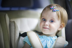 Happy little baby girl in the car seat Royalty Free Stock Photos