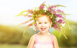 Happy little baby girl child in summer wreath Royalty Free Stock Photos