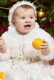 Happy little baby girl playing with fruits Stock Image