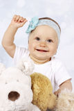 Happy little baby girl among plush toys Royalty Free Stock Photo