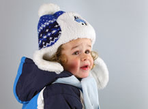 Happy little baby in a huge hat on white blackground stock photo