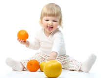 Happy little baby playing with fruits Stock Photos