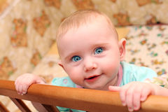 Happy Baby in Bassinet Royalty Free Stock Photos