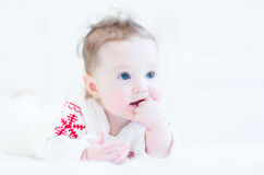 Happy little baby in a red and white nordic sweater Stock Photography