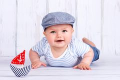 Happy little baby sailor crawling on the floor Stock Photography