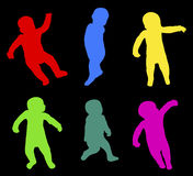 Happy little baby silhouettes Royalty Free Stock Photography