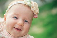 Happy little baby smiling. Happy newborn baby. Adorable little girl smile. Parenting time. Happy childhood and. Parenthood. Your smile is our smile. The thing stock photography