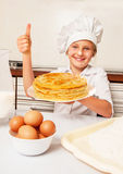 Happy little baker with tasty pancakes Royalty Free Stock Photo