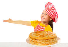 Happy little baker with tasty pancakes Stock Image