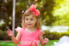 Happy little beautiful girl in pink dress Stock Image