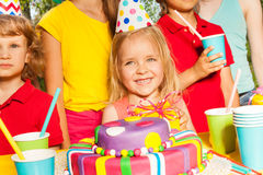 Happy little blond girl with birthday gift Royalty Free Stock Photo