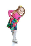 Happy little blond girl poses for the camera Stock Photos