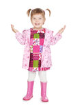 Happy little blonde girl in pink boots Stock Photo