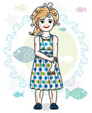 Happy little blonde girl posing on marine background with fishes Royalty Free Stock Images