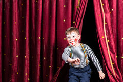 Happy little boy actor making his entrance Royalty Free Stock Photography