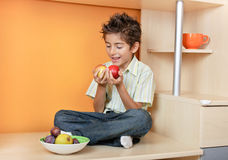 Happy little boy with apples Royalty Free Stock Photography