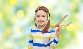 Happy little boy in aviator hat with airplane Royalty Free Stock Photography