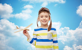 Happy little boy in aviator hat with airplane Royalty Free Stock Image
