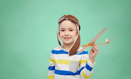 Happy little boy in aviator hat with airplane Stock Photo